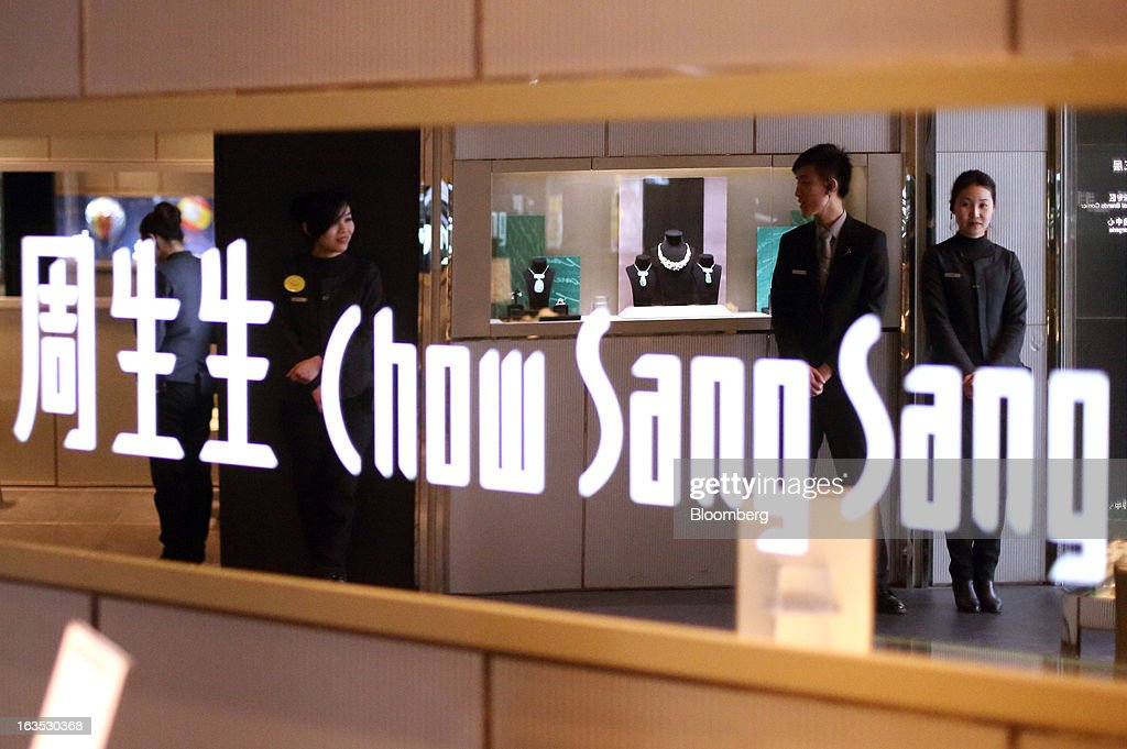Employees are reflected in a mirror with the Chow Sang Sang Holdings International Ltd. logo in the company's jewelry store in the Sanlitun district of Beijing, China, on Monday, March 11, 2013. China's consumer prices climbed 3.2 percent from a year earlier, according to figures released March 9, exceeding January's 2 percent gain and the median estimate for a 3 percent increase in a Bloomberg survey of analysts. Photographer: Tomohiro Ohsumi/Bloomberg via Getty Images