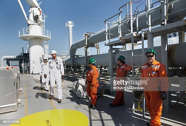 Employees are seen on board the Expedient regasification ship anchored off the coast of Israel in the Mediterranean Sea on February 26 as natural gas...