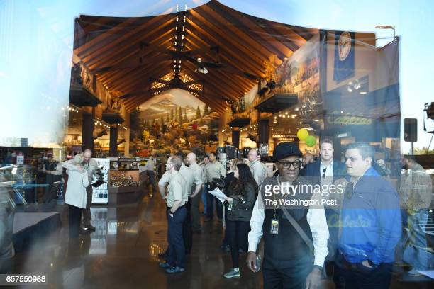 Employees are seen through a window before the opening of the new Cabela's store on Thursday March 09 2017 in Gainesville VA