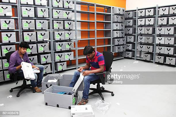 Employees arrange clothing into boxes in the office of Myntracom a unit of Flipkart Internet Services Pvt in Bangaluru India on Friday Dec 04 2015...
