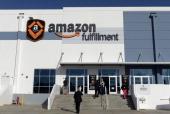 Employees arrive at Amazon's San Bernardino Fulfillment Center October 29 2013 in San Bernardino California Amazon's 1 millionsquarefoot facility in...
