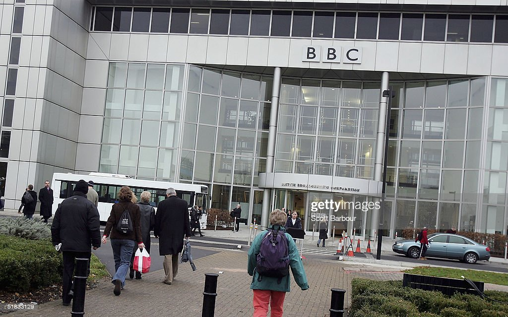 BBC employees arrive at the BBC headquarters on December 7, 2004 in London, England. About 2,900 jobs are expected to be cut at the British Broadcasting Corporation, resulting in savings that are needed so that more of the money from licence fees can be put into programmes.