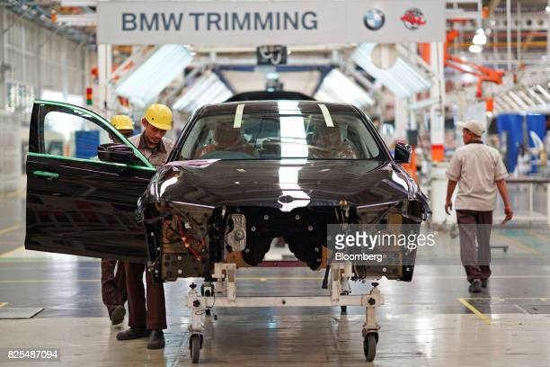 Employees assemble a BMW 530i sedan on the production line at a PT Gaya Motor plant in Jakarta Indonesia on Wednesday Aug 2 2017 BMW is scheduled to...
