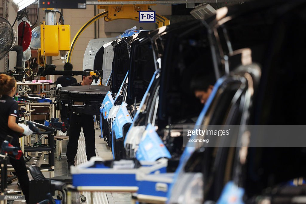 Employees assemble BMW AG X3 vehicles at a BMW manufacturing plant in Pluak Daeng, Rayong Province, Thailand, on Tuesday, May 3, 2016. BMW's profit declined 2.5 percent in the first quarter on investment in new technologies like self-driving cars to defend its status as the world's biggest maker of luxury vehicles. Photographer: Dario Pignatelli/Bloomberg via Getty Images