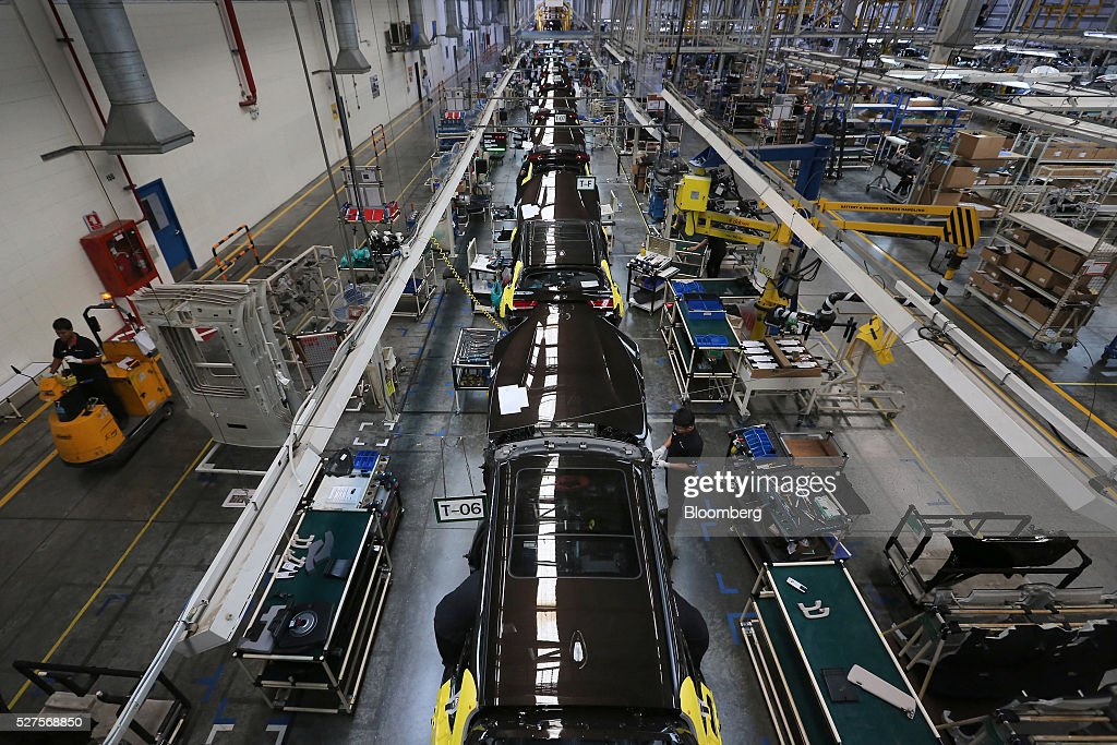 Employees assemble BMW AG X5 vehicles at a BMW manufacturing plant in Pluak Daeng, Rayong Province, Thailand, on Tuesday, May 3, 2016. BMW's profit declined 2.5 percent in the first quarter on investment in new technologies like self-driving cars to defend its status as the world's biggest maker of luxury vehicles. Photographer: Dario Pignatelli/Bloomberg via Getty Images
