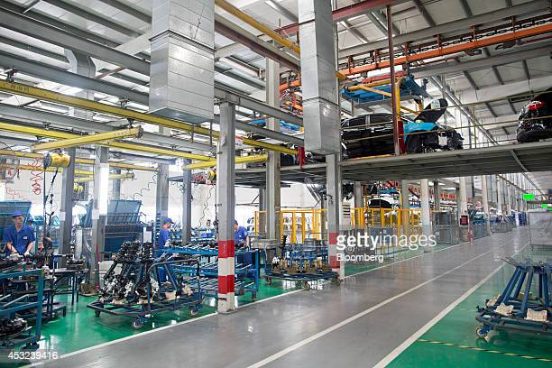 Employees assemble brake pads for BYD Co S6 sportutility vehicles at the company's assembly plant in the Pingshan district of Shenzhen China on...