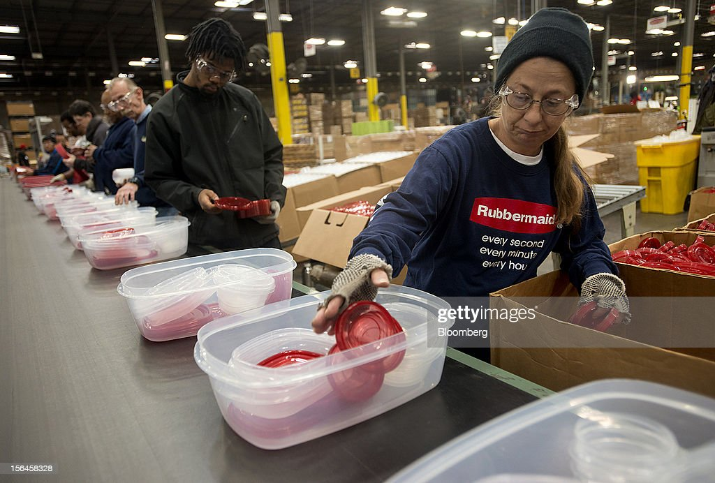 Employees assemble food containers to packaged on a production line at the Newell Rubbermaid Inc. factory in Mogadore, Ohio, U.S., on Thursday, Nov. 15, 2012. The U.S. Federal Reserve is scheduled to release monthly industrial production data on Nov. 16. Photographer: Ty Wright/Bloomberg via Getty Images