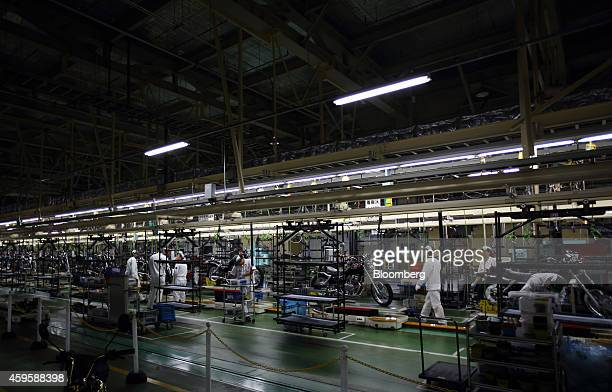 Employees assemble Honda Motor Co Rebel 250 motorcycles on the production line of the company's Kumamoto factory in Ozu Kumamoto Prefecture Japan on...