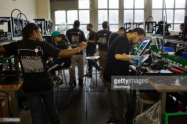 Employees assemble Makerbot Industries LLC 3D Printers at the company's new factory in the Brooklyn borough of New York US on Thursday June 7 2013...
