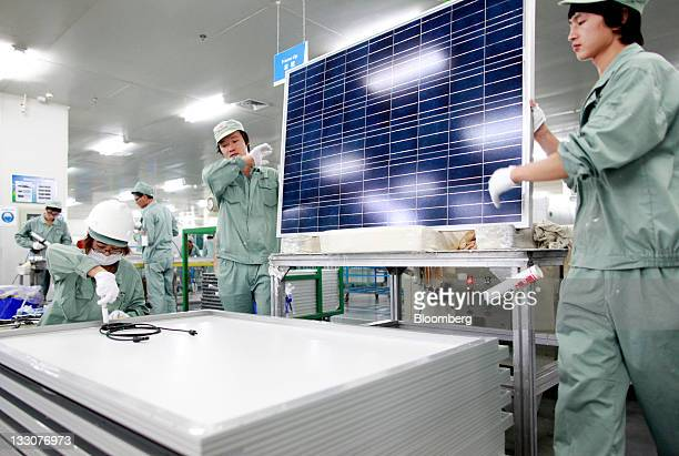 Employees assemble photovoltaic panels at Suntech Power Holdings Co's factory in Wuxi Jiangsu Province China on Wednesday Nov 16 2011 Suntech Power...
