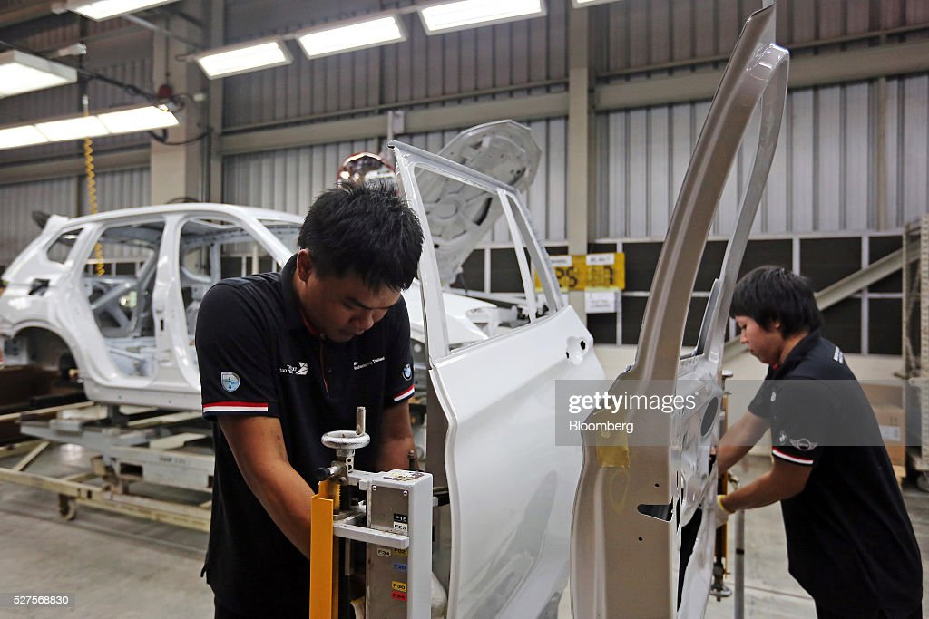Employees assemble the doors of a BMW AG X3 vehicle at a BMW manufacturing plant in Pluak Daeng, Rayong Province, Thailand, on Tuesday, May 3, 2016. BMW's profit declined 2.5 percent in the first quarter on investment in new technologies like self-driving cars to defend its status as the world's biggest maker of luxury vehicles. Photographer: Dario Pignatelli/Bloomberg via Getty Images