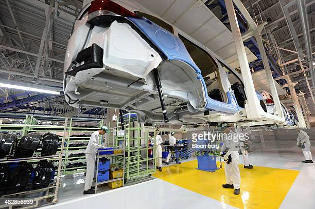 Employees assemble the Honda Motor Co Mobilio multipurpose vehicle at the PT Honda Prospect Motor factory in Karawang Indonesia on Wednesday Jan 15...