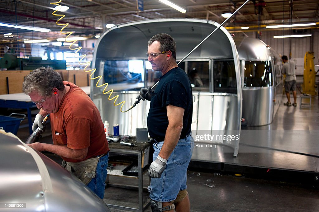 Employees assemble the rear end of a trailer in the Airstream Inc. manufacturing facility in Jackson Center, Ohio, U.S., on Wednesday, June 6, 2012. The U.S. Federal Reserve is scheduled to release industrial production data on June 15. Photographer: Ty Wright/Bloomberg via Getty Images