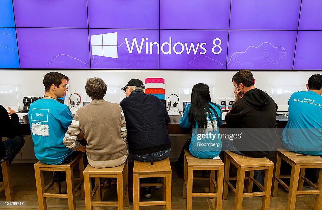 Employees assist customers at the opening of a Microsoft Corp. store in Bellevue, Washington, U.S., on Friday, Oct. 26, 2012. Microsoft Corp. introduced the biggest overhaul of its flagship Windows software in two decades, reflecting the rising stakes in its competition with Apple Inc. and Google Inc. for the loyalty of customers who are shunning personal computers and flocking to mobile devices. Photographer: Stuart Isett/Bloomberg via Getty Images