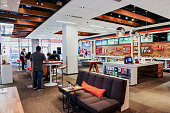 Employees assist customers inside an ATT Inc store in New York US on Friday July 22 2016 ATT posted secondquarter profit that was in line with...