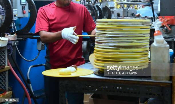 Employees at Erika Records work in the record pressing plant in Buena Park California on April 12 where Erika Records has been pressing vinyl in its...