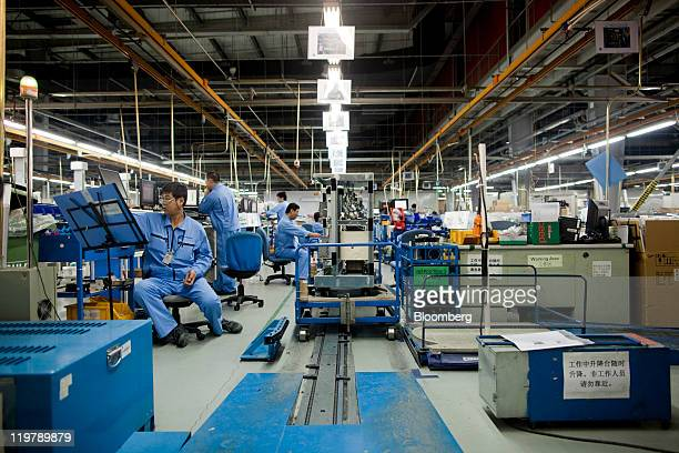 Employees at the General Electric Co healthcare unit's production facility work to assemble medical Xray devices in Beijing China on Friday July 22...