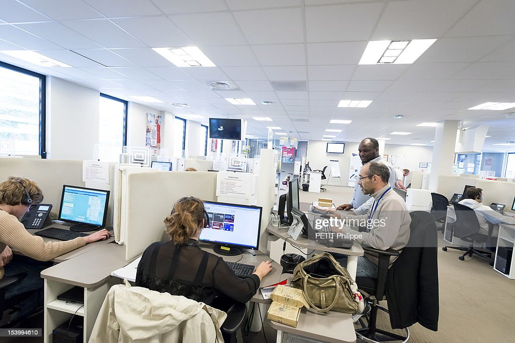 Employees at Webhelp work despite the county's financial crisis in the offices of the company on October 4, 2012 in Compiegne, France.