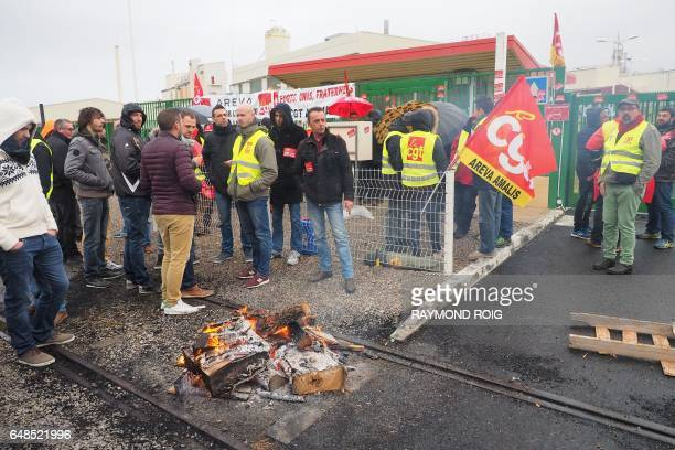 Employees block the access to the Malvesi site an uranium conversion plant of French nuclear group Areva during a protest against the direction's...