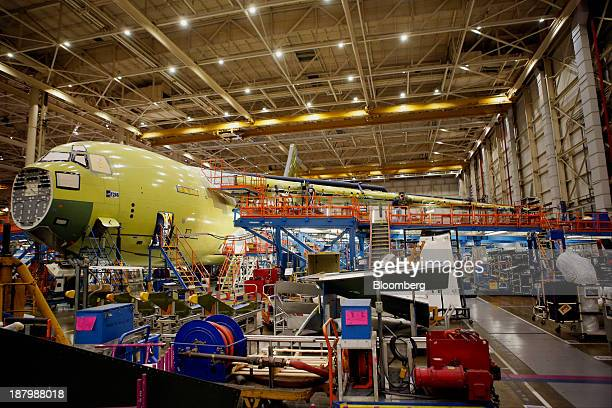 Employees build a Boeing Co C17 Globemaster III military cargo jet at the company's C17 final assembly facility in Long Beach California US on...
