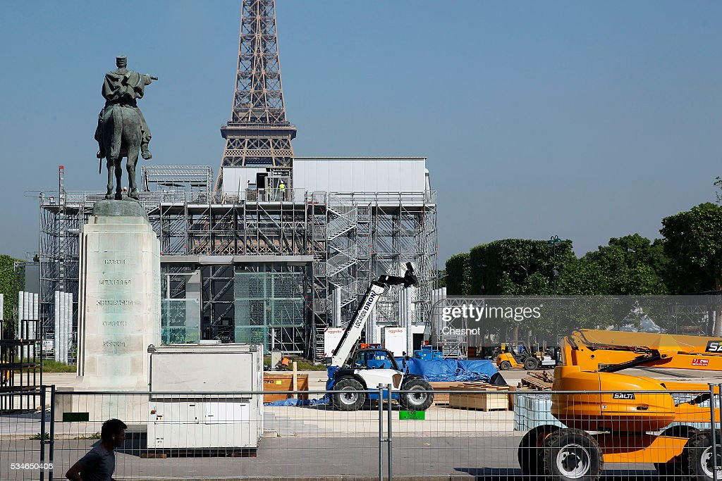 Employees build the Fan Zone near the Tour Eiffel in preparation for the UEFA 2016 European Championship on May 27, 2016 in Paris, France. The Euro 2016 fan zone in the French capital would be operated under the 'highest standards of security' as it prepares to accommodate over 90,000 football supporters.