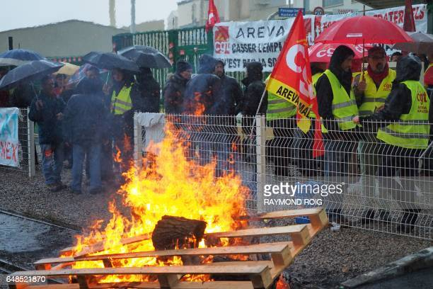 Employees burn wooden paletts as they block the access to the Malvesi site an uranium conversion plant of French nuclear group Areva during a protest...