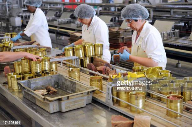 Employees can tuna on July 8 2013 at the Gonidec canning fish factory in Concarneau western of France Gonidec canning fish factory in Concarneau...