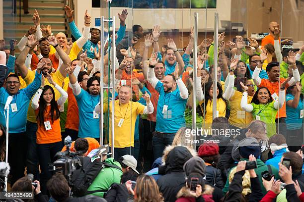 Employees celebrate the grand opening of Microsoft's first flagship store as customers are let into the store on Fifth Avenue on October 26 2015 in...