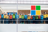 Employees celebrate the grand opening of Microsoft's first flagship store on Fifth Avenue on October 26 2015 in New York City Hundreds of eager...