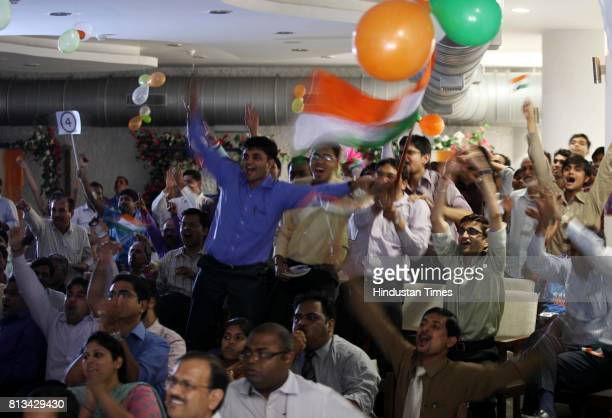 RPG employee's celebrates during the match between India and Pakistan at worli on Wednesday