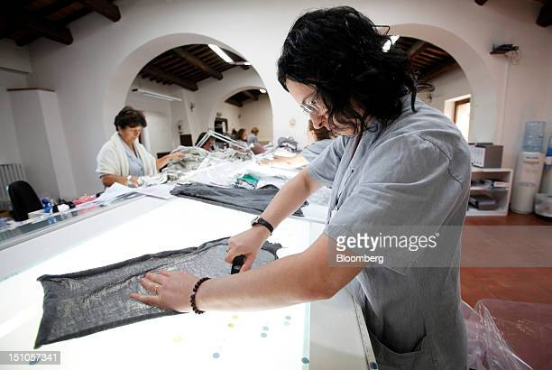 Employees check garments for defects during the quality control process at the Brunello Cucinelli SpA production facility in Solomeo near Perugia...