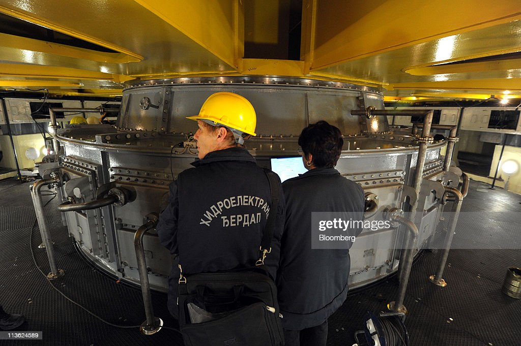 Employees check the 176-megawatt generator number 6 at Djerdap 1, Serbia's largest hydro-electric power plant which is operated by Elektroprivreda Srbije, on the Danube river in Kladovo, Serbia, on Wednesday, May 4, 2011. Serbia expects as much as 9 billion euros ($13.4 billion) to be invested in the overhaul and development of its energy sector by 2015, according to Dusan Mrakic, a state secretary with the Energy and Mining Ministry. Photographer: Oliver Bunic/Bloomberg via Getty Images