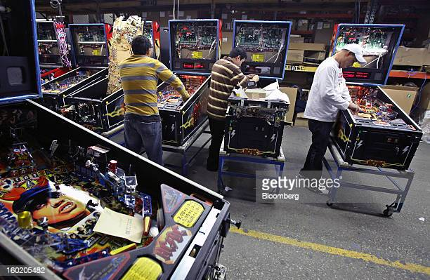 Employees check the mechanics and electronics of pinball machines nearing completion at Stern Pinball Inc the world's only maker of arcadequality...