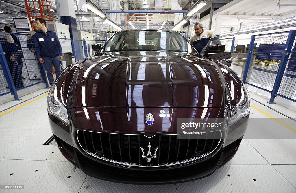 Employees check the wheel alignment during the production of a Maserati Quattroporte luxury automobile at Fiat SpA's Grugliasco factory in Turin, Italy, on Wednesday, Jan. 30, 2013. Fiat SpA Chief Executive Officer Sergio Marchionne said the Italian carmaker narrowed losses in Europe in the fourth quarter, helping it achieve full-year earnings that were in line with its forecasts. Photographer: Alessia Pierdomenico/Bloomberg via Getty Images