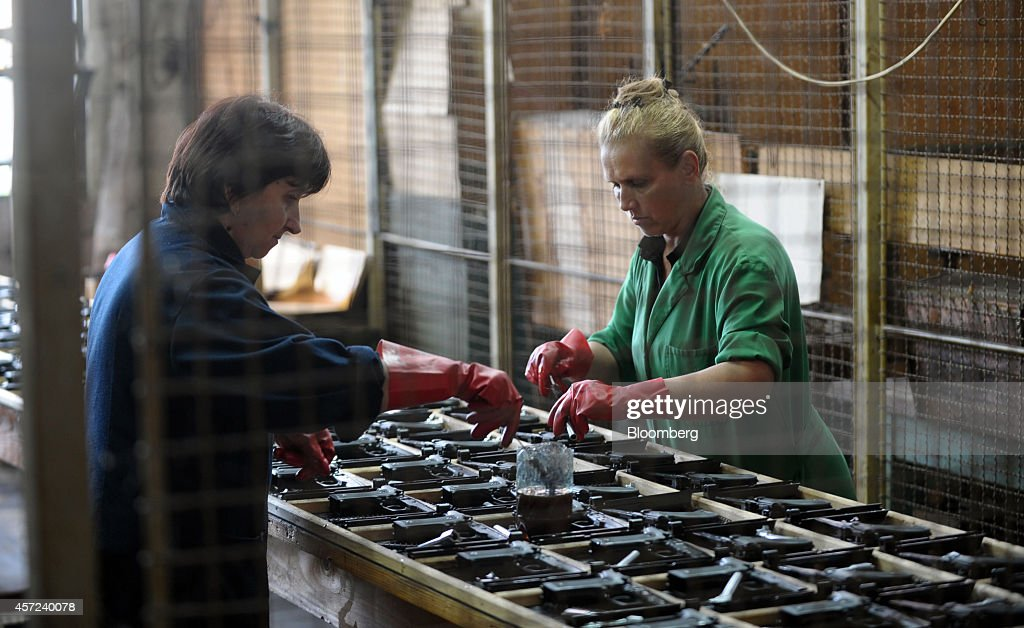 Employees clean CZ999 Scorpion semiautomatic handguns manufactured by Zastava Arms on the production line at the Zastava Oruzje AD firearms factory...