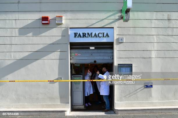 Employees close the iron curtain of a pharmacy during a demonstration against the European Union on March 25 2017 in Rome Italian capital hosts a...