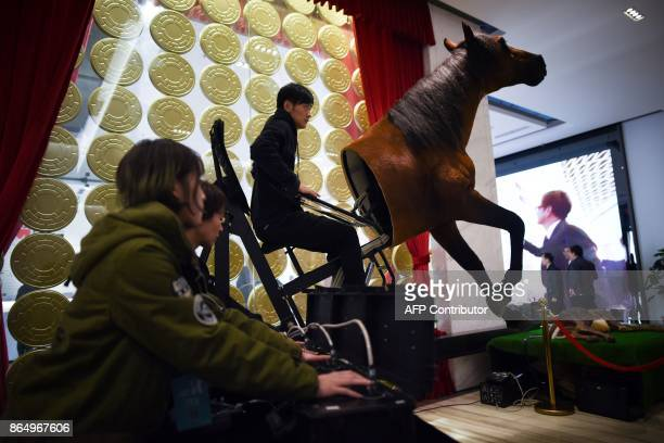 Employees control the model of a horse at a film production company in Dachang county in Langfang city in China's Hebei province on October 22 2017 /...