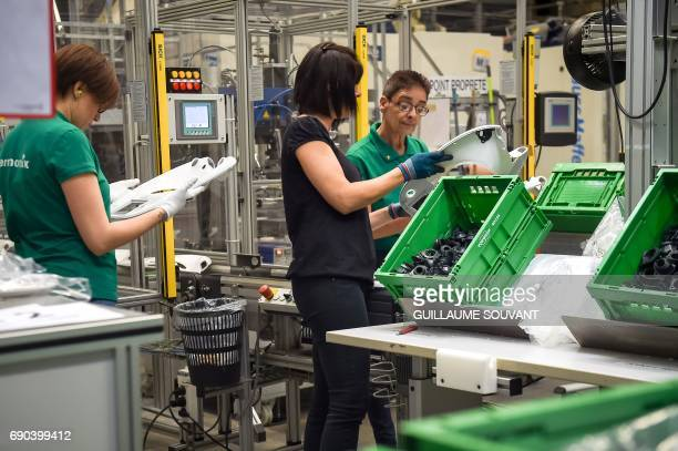 Employees control the quality of product at a production plant of German group VorwerkSemco where the Thermomix kitchen foodprocessor is manufactured...