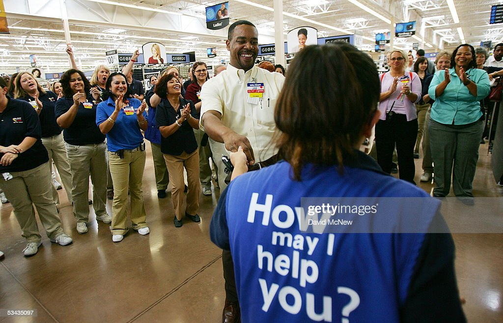 Employees dance and cheer during their daily staff meeting at the soontobeopened WalMart Palmdale Supercenter department store on August 18 2005 in...