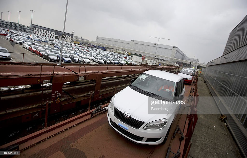 Employees drive newly-manufactured Skoda Fabia automobiles onto rail wagons transport trucks for distribution at the Skoda Autos AS plant in Mlada Boleslav, Czech Republic, on Friday, March 15, 2013. VW, which also owns the Porsche luxury-auto brand as well as the Skoda and Seat volume marques, will build at least 10 plants globally, including seven in China, Martin Winterkornm chief executive officer of Volkswagen AG, said. Photographer: Martin Divisek/Bloomberg via Getty Images