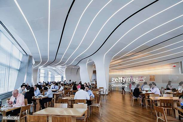 Employees eat lunch in the cafeteria of the Goldman Sachs Group Inc office in New York US on Thursday Sept 10 2015 Many of Wall Street's biggest...