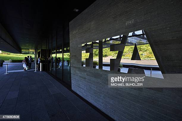 FIFA employees enter at the FIFA headquarters on June 3 2015 in Zurich Blatter resigned on June 2 2015 as president of FIFA as a mounting corruption...