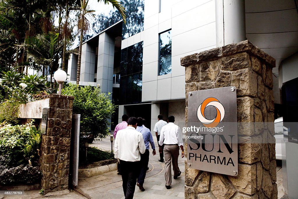 Employees enter the Sun Pharmaceutical Industries Ltd. corporate office in the Andheri suburb of Mumbai, India, on Monday, April 7, 2014. Sun Pharmaceutical, India's largest drugmaker by market value, agreed to buy Ranbaxy Laboratories Ltd. for $3.2 billion in stock, the biggest purchase by an Indian company in two years. Photographer: Amit Madheshiya/Bloomberg via Getty Images