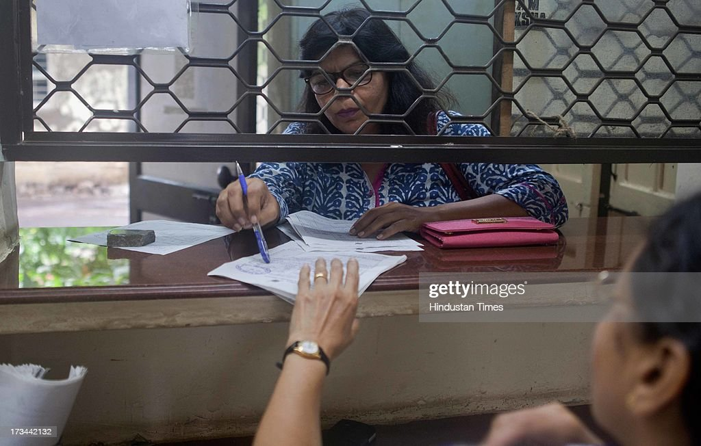 Employees feed in telegram messages to be sent via telegraph at a telecommunications office at Santacruz on July 14, 2013 in Mumbai, India. The work to lay telegraph lines started in 1850 on an experimental basis between Koklata and Diamond Harbour, it was opened for use by the British East India Company the following year. In 1854, the service was made available to the public. 163-year-old telegram service is being shut down by the Government from 15th of July, across the country.