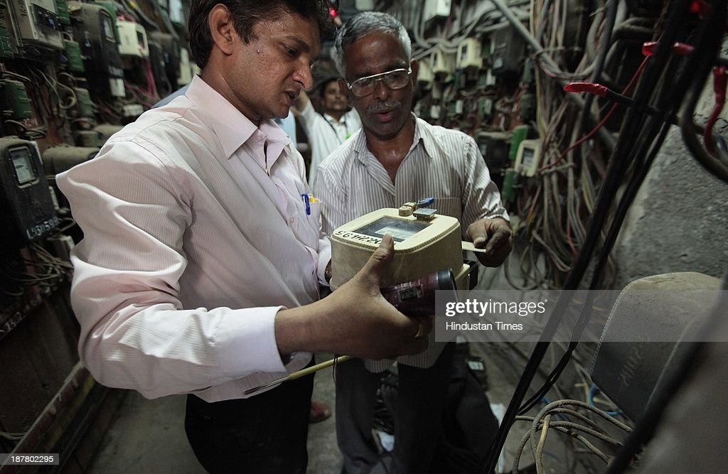 Employees from BEST reach the spot to disconnect electricity supply in vacant flats in Campa Cola compound on November 12, 2013 in Mumbai, India. Seven high-rises were constructed at what is called the Campa Cola Compound, between 1981 and 1989. The builders had permission for only five floors, but constructed several more. One of the buildings, Midtown, has 20 floors. Another building, Orchid, has 17. The Supreme Court asked the BMC to investigate, and the civic body served demolition notices for all flats constructed above the fifth floor, which it said were illegal.