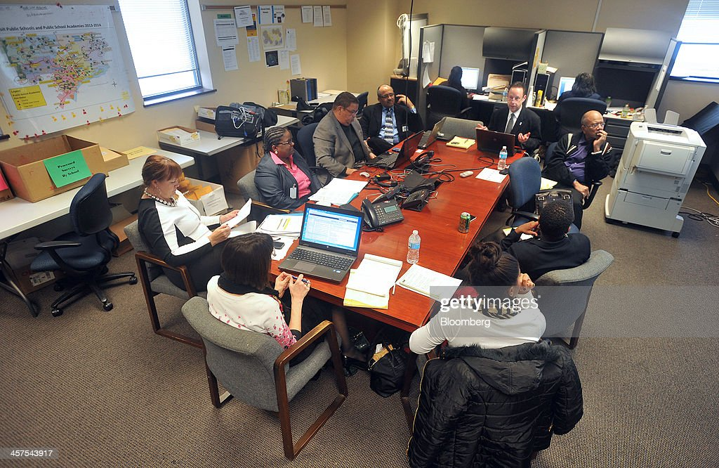 Employees from Detroit Public Schools hold a strategy meeting in the 'war room' at DPS offices in Detroit, Michigan, U.S., on Wednesday, Dec. 11, 2013. An all-out battle to attract Detroits dwindling pool of students is engulfing the citys competing schools even as plans for a civic renaissance count on them to retain residents and stabilize neighborhoods. Photographer: Bryan Mitchell/Bloomberg via Getty Images
