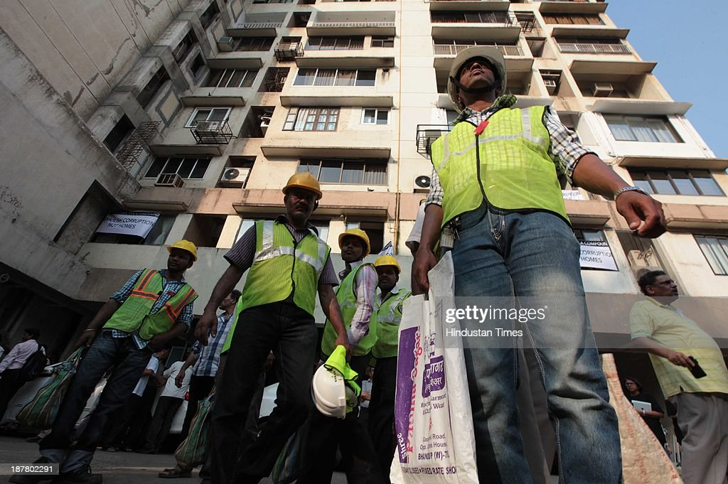Employees from Mahangas Gas Ltd reach the spot to disconnect gas connection in vacant flats in Campa Cola compound on November 12, 2013 in Mumbai, India. Seven high-rises were constructed at what is called the Campa Cola Compound, between 1981 and 1989. The builders had permission for only five floors, but constructed several more. One of the buildings, Midtown, has 20 floors. Another building, Orchid, has 17. The Supreme Court asked the BMC to investigate, and the civic body served demolition notices for all flats constructed above the fifth floor, which it said were illegal.