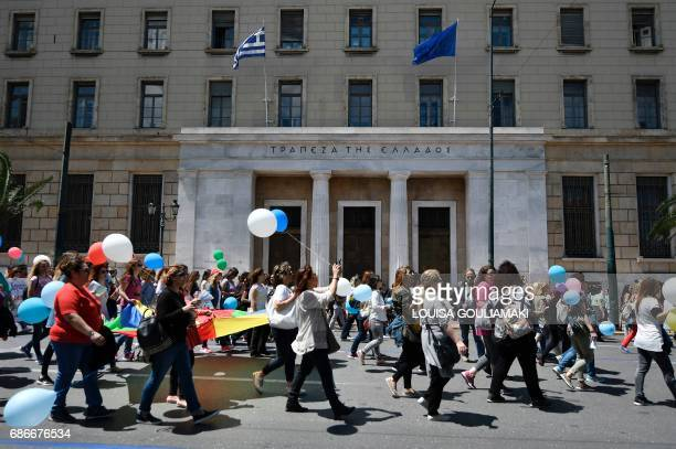 Employees from the municipal kindergardens march past the bank of Greece in Athens on May 22 2017 during their 48hour strike Municipal workers on a...