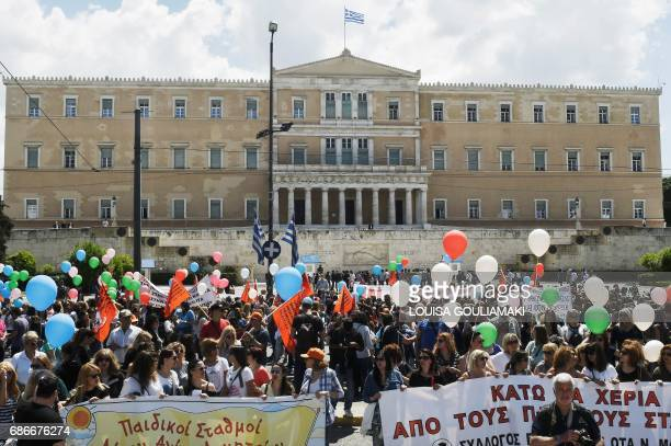 Employees from the municipal kindergardens protest outside the Greek parliament in Athens on May 22 2017 during their 48hour strike Municipal workers...