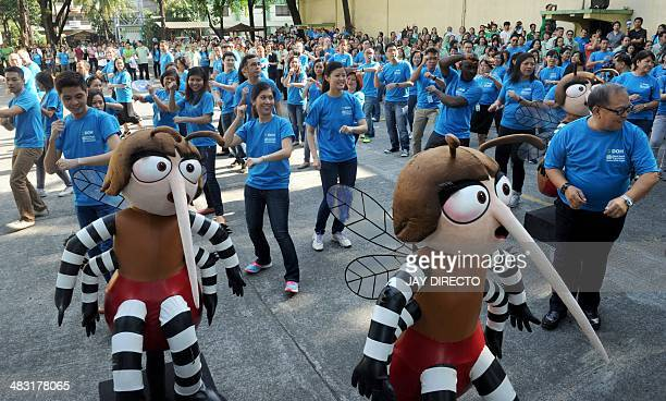 Employees from the Philippines Department of Health perform a 'mosquito dance' with mascots to create public awareness of vectorborne diseases in...